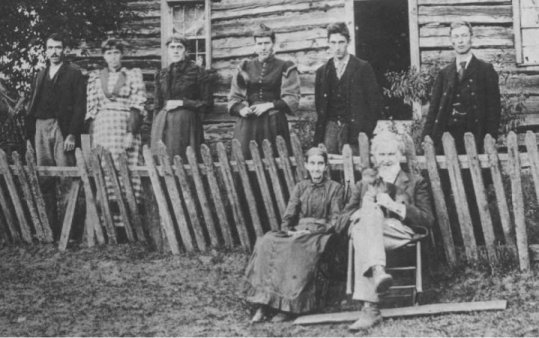 Benoni Mitchell Family, Lewis County, West Virginia Abt. 1894 Seated: Wife, Susan Life Mitchell (1819-1902) Benoni Mitchell (1815-1903) Standing from left: 1)Son-in-law Bruce Scott; 2) Daughter Isadore Mitchell Scott; 3) Daughter Bell Mitchell; 4) Daughter Susan Florence Mitchell; 5) Grandson John A. Henderson (1875-1968 - son of daughter Alice Mitchell Henderson, Deceased); 6)Charles Alkire (unrelated)**