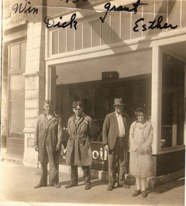 In front of Tong Implement, Findlay, Ohio L to R:  Winfield (Win) Tong, Dick (not sure who this is), Grant Tong, Esther Tong
